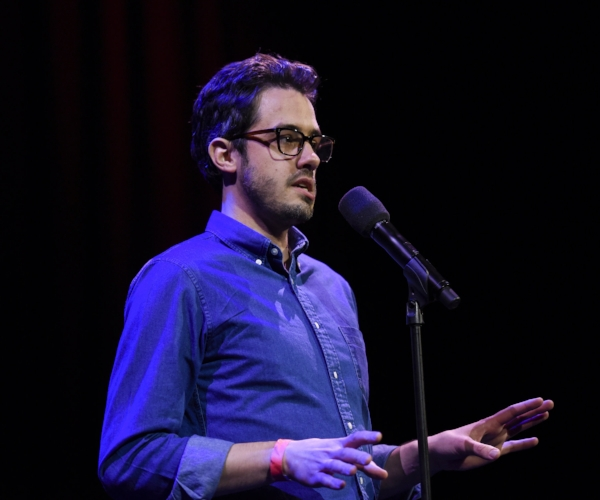 Dan Souza shares his story at the Oberon Theatre in Cambridge, Massachusetts. Photo by Kate Flock.