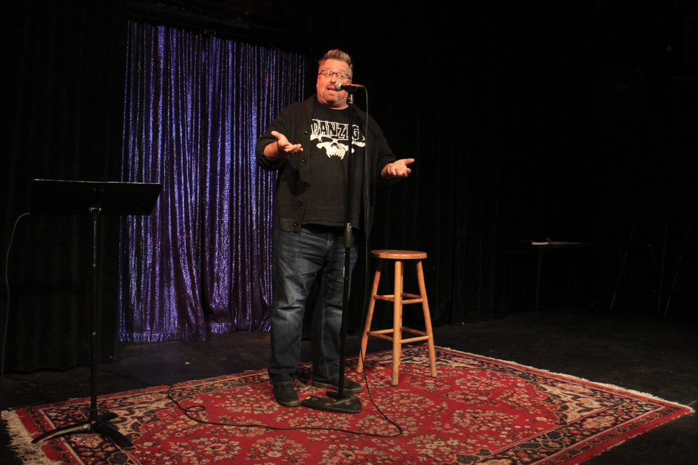 Brian D. Bradley shares his story on the Story Collider stage in Los Angeles at the Lyric Hyperion in May 2018. Photo by Mari Provencher.