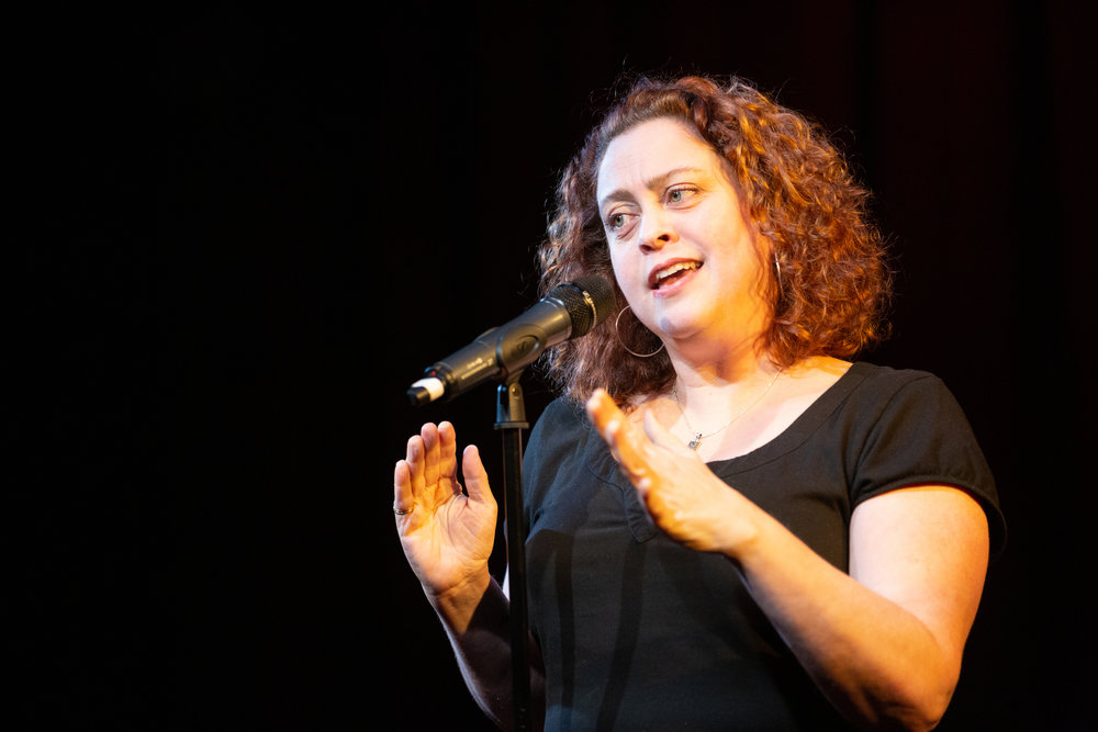 Edith Gonzalez shares her story on the Story Collider stage at Caveat in NYC in February 2019. Photo by Zhen Qin.