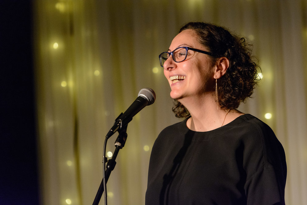 Meltem Alemdar shares her story with the Story Collider at the Highland Inn and Ballroom in Atlanta, GA in January 2019. Photo by Rob Felt.