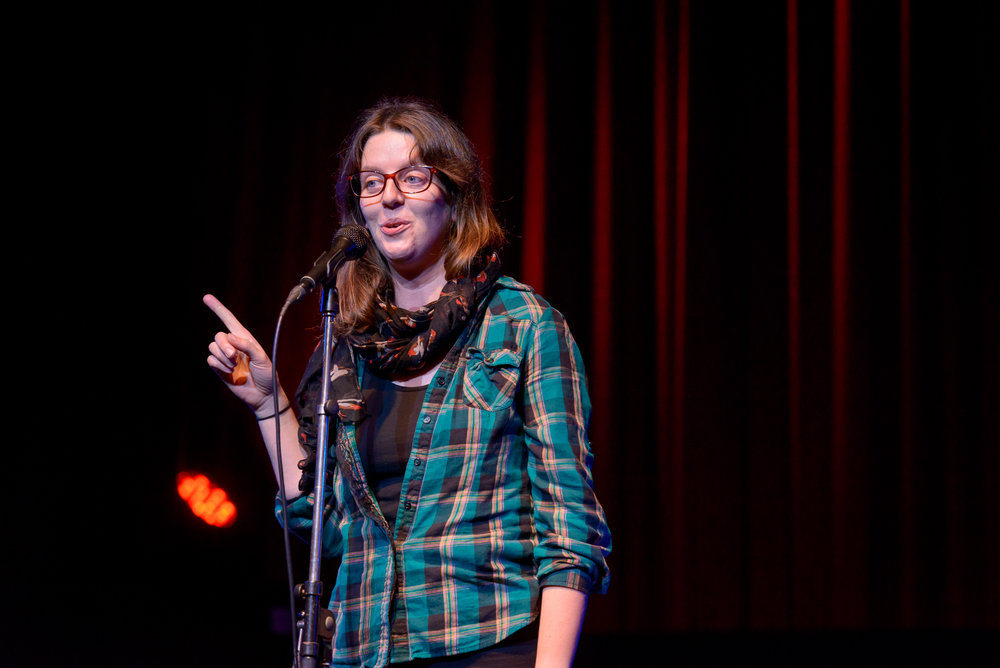 Laura Kehoe shares her story on the Story Collider stage at Fox Cabaret in Vancouver, BC in October 2018. Photo by Rob Shaer.