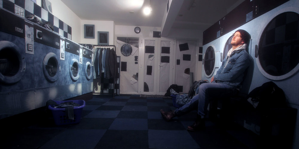 Ian Berry in his Laundrette installation all made of denim