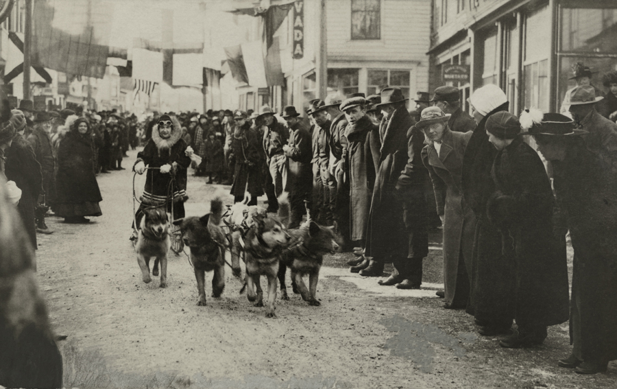 Got a Girl Crush On: A female musher participating in a dog sled race through Nome, Alaska, March 1919      Photograph by Thomas A. Ross, National Geographic    (via  natgeofound )