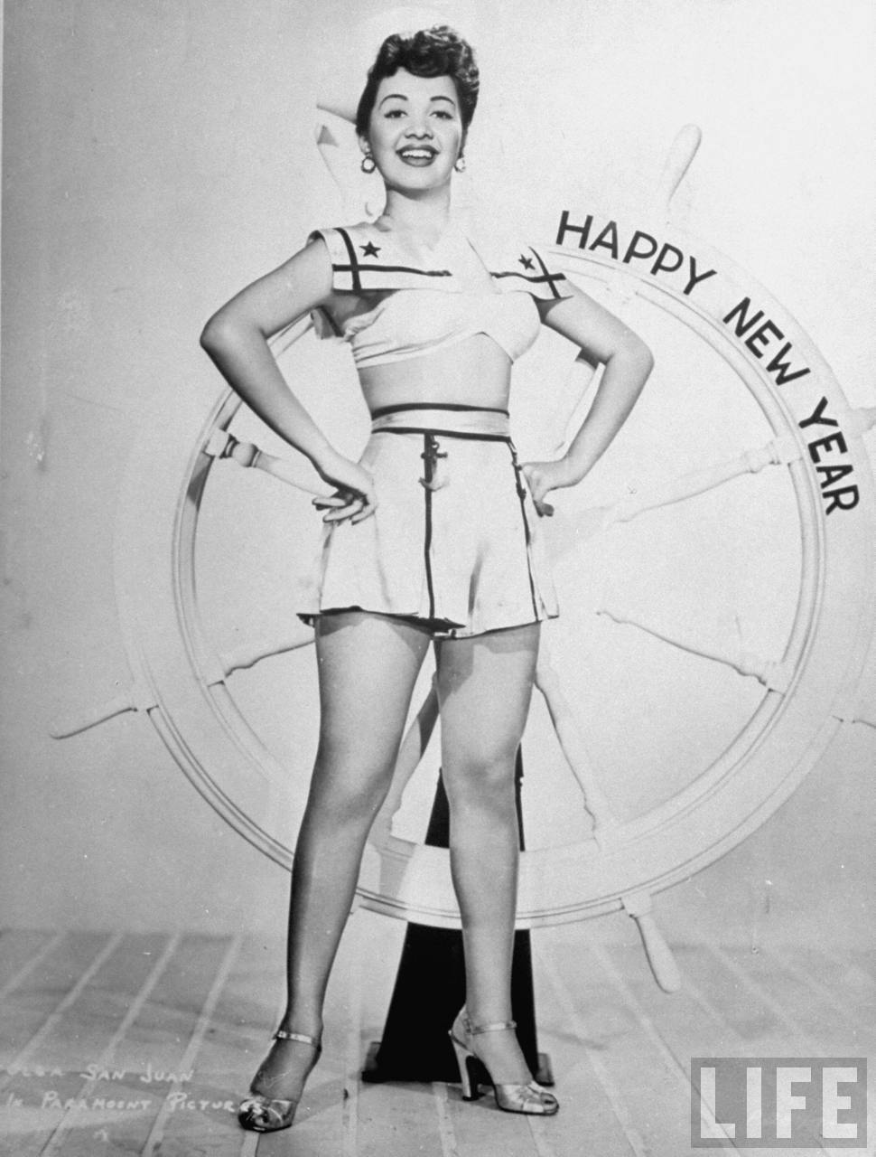 "Got a Girl Crush On: ""The Puerto Rican Pepper Pot"" Olga San Juan posing for publicity still with nautical theme bearing message: HAPPY NEW YEAR (1944)"