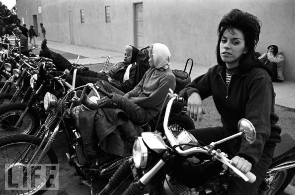 "The Old Ladies - Never-Seen: Hells Angels, 1965 Photo by Bill Ray Got a girl crush on: The Old Ladies ""One thing about the Angels that I found fascinating,"" Ray told LIFE.com, ""and something I'd never given much thought to before I started photographing them, was the role that the women played. The girls weren't there in chains, or against their will or anything. They had to want that life if they were going to be accepted by the Angels. These guys were kings of the road. I don't think they ever felt they had to look around for girls. Girls would come to them, and they would take their pick. And then they'd tell them where to sit and what to do."" I did a little research after seeing this photo and learned that an ""old lady"" referred to a steady girlfriend or wife of a Hell's Angel outlaw. This is not to be confused with a ""mama"" or ""strange chick"", which was more or less a term for groupies–girls who were always available. For example, there was the common expression ""Let's go make a mama"". However, if you were considered an ""old lady"", it meant that you were spoken for and all other Angels knew to back off. (via LIFE)"