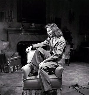 "Got A Girl Crush On: Katherine Hepburn as Tracy Lord in ""A Philadelphia Story"" Talk about a saucy broad. Not sure how this movie had slipped passed my seeing until this past weekend, but check the plot of this classic from 1940:  Tracy Samantha Lord Haven (Katharine Hepburn) is a wealthy socialite who had divorced C. K. Dexter Haven (Cary Grant), because he did not measure up to her exacting standards. She is about to marry nouveau riche ""man of the people"" George Kittredge. The publisher of Spy magazin is eager to cover the wedding, and blackmails Dexter into introducing tabloid reporter Macaulay ""Mike"" Connor (Jimmy Stewart) and photographer Liz Imbrie (Ruth Hussey) as friends of the family so they can report on the wedding. Tracy is not fooled, but reluctantly agrees to let them stay, after Dexter explains that Kidd has an innuendo-laden article about Tracy's father.  Dexter is welcomed back with open arms by Tracy's mother and teenage sister Dinah, much to Tracy's annoyance. In addition, Tracy gradually discovers that Mike has admirable qualities. Thus, as the wedding nears, Tracy finds herself torn between her fiancé, her ex-husband, and the reporter. The night before the wedding, Tracy gets drunk for only the second time in her life and takes an innocent swim with Mike. When George sees Mike carrying an intoxicated Tracy into the house afterwards, he thinks the worst. The next day, he tells her that he was shocked and feels entitled to an explanation before going ahead with the wedding. Tracy takes exception to his lack of faith in her and breaks off the engagement. Then she realizes that all the guests have arrived and are waiting for the ceremony to begin. Mike volunteers to marry her, but Tracy graciously declines. At this point, Dexter makes his bid for her hand, which she accepts Marriage! Divorce! Ex husband! Fiance! Swimming with reporters! Kate fires on all cylinders and takes no crap from anyone, and even while wearing pants! Seriously 1940 had some on 2010!"
