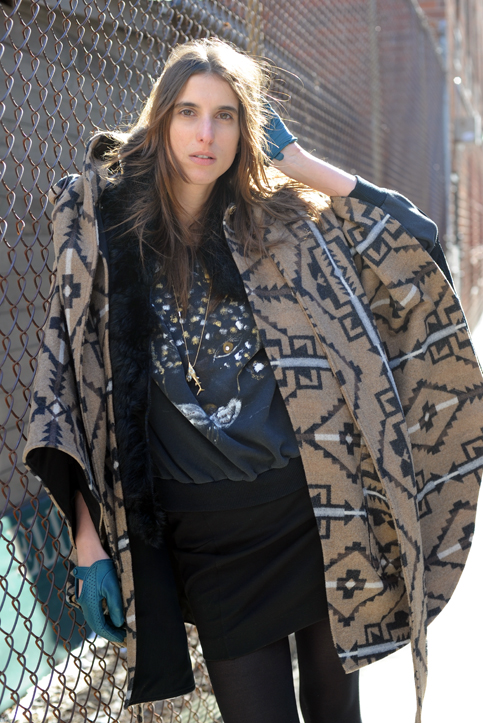 Got a girl crush on: Nicola The giant southwestern blanket cape, the perforated glove, the cheetah sweatshirt, the gold fish pendant. This ensemble is all sorts of win. (via Turned Out)