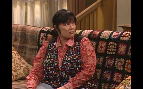 "Got a girl crush on:    THIRD AND DELAWARE     Just when you think The Internet has offered all that it has to offer, it throws you a mega curveball of awesome and knocks you off your feet. Introducing,  Third and Delaware:  Fashion highlights from every single episode of Roseanne.   A sampling:      S6E22: Roseanne's Button Bedazzled Vest     The housewife's oft-heard lament: ""What to do with all of those spare buttons clogging up my sewing kit!?""  Roseanne's crafty answer: sew them all onto a vest!  Not only is she freeing up space for a some new rolls of thread, she's gone and made herself a piece of handmade heaven!  Also, it makes it easier to track down a spare button should Dan lose one as he rips his shirt off in the ""heat of the moment""!  Paired with a red paisley shirt, this look is really working for Roseanne!      This is ample motivation to put all 9 seasons of Roseanne on the Netflix queue and watch it in parallel with this blog.   (via  TeenAngster , a new favorite!)"