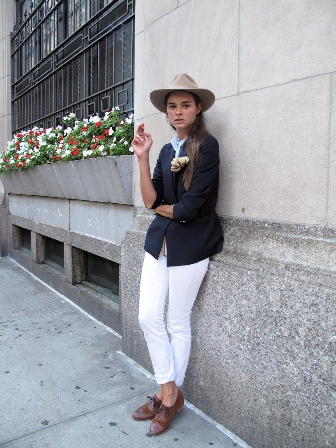 Got a girl crush on: Indiana Jones' Color-Minded Sister    I'm a little infatuated with every part of this finely tuned outfit. The thing that pulls it altogether is that every color is just the right tone: the taupe Indiana Jones-style fedora, the rich navy blazer, the light blue oxford button-up, the clean white rolled jeans (that show the perfect amount of ankle), and the whiskey brown oxfords are perfect complements to each other. Hue making me crazy!   (Photo via  Face Hunter )