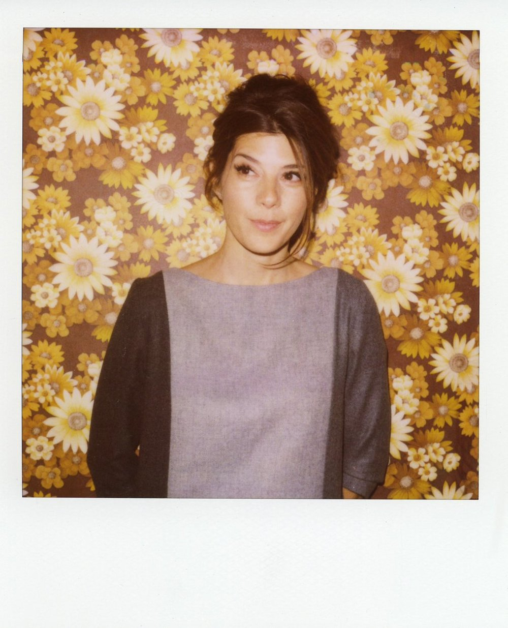 Got a girl crush on: Marisa Tomei in Boy. by Band of Outsiders     Marisa Tomei models  Boy by Band of Outsiders . Scott Sternberg and I seem to have the same girl crushes.   You and me both, icanmakewaffles!…all right it's more of a crush on Boy. by Band of Outsiders, which is cheating because it's actually designed by a guy–the dapper Scott Sternberg (what I  don't  have a crush on, though, are their prices. Oh, lawdy lawdy lawdy!). But we can let these things slip once in a while, right? I've loved their picks for models so far: Kirsten Dunst, Sarah Silverman and now Marisa Tomei. Scott sure knows how to sell to women. More adorable polaroids of Marisa strutting her stuff  here .   (via  icanmakewaffles )