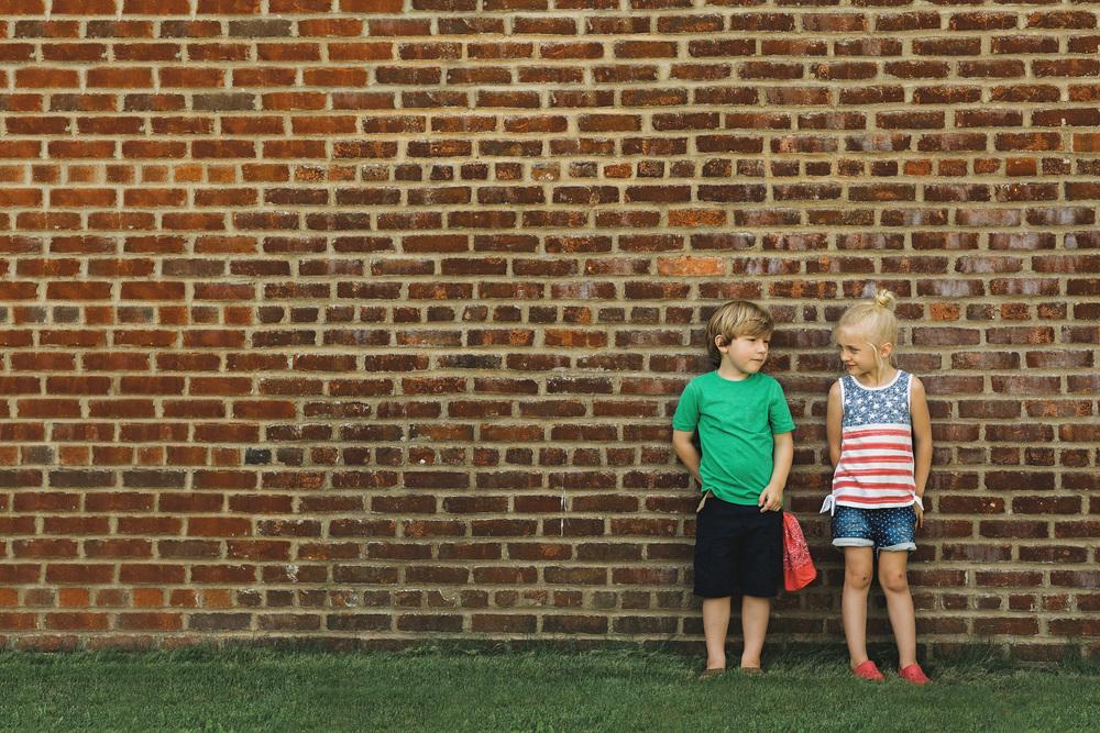 hello-olivia-photography-long-island-photographer-brick-wall-kids.jpg