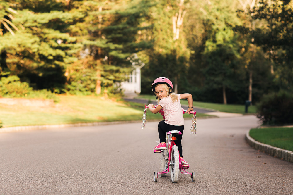 hello-olivia-photography-be-awesome-bicycle-pink-helmet-street-neighborhood-training-wheels.jpg