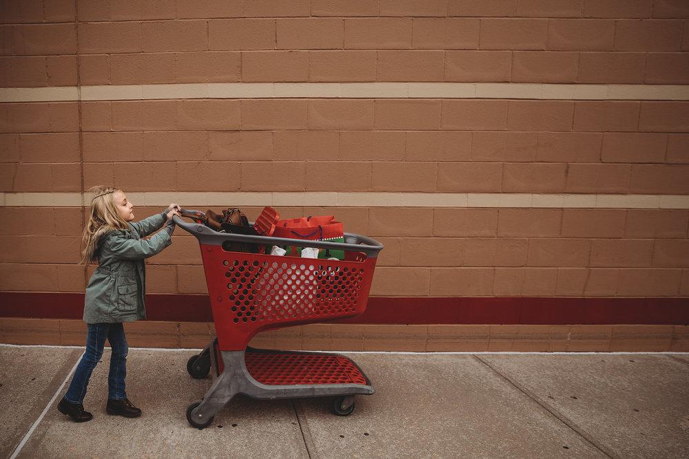 hello-olivia-photography-long-island-photographer-lifestyle-child-medford-stuufolk-target-shopping-cart.jpg