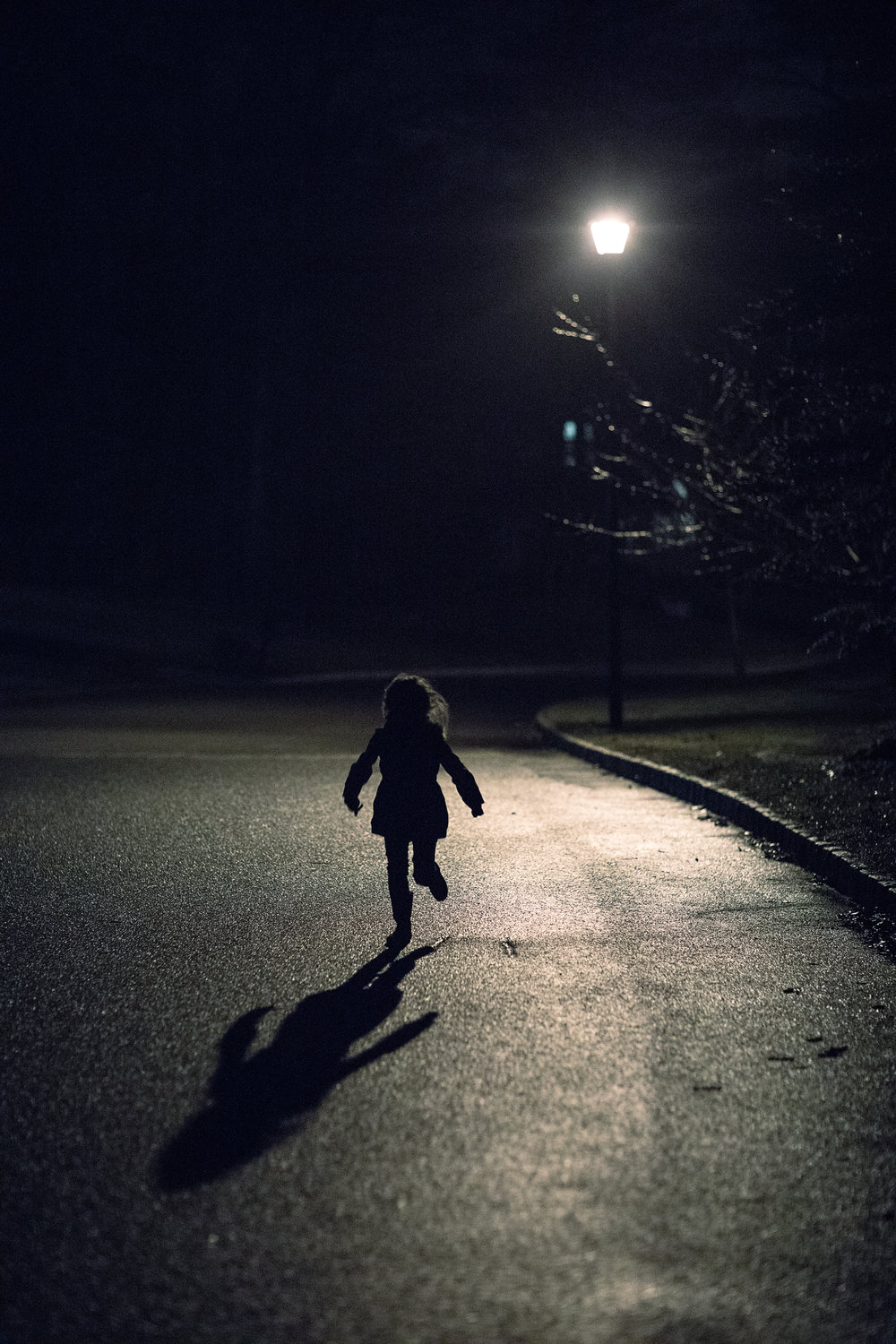 hello-olivia-photography-long-island-photographer-lifestyle-child-outside-dark-lamp-light-low-light-shadow-run.jpg