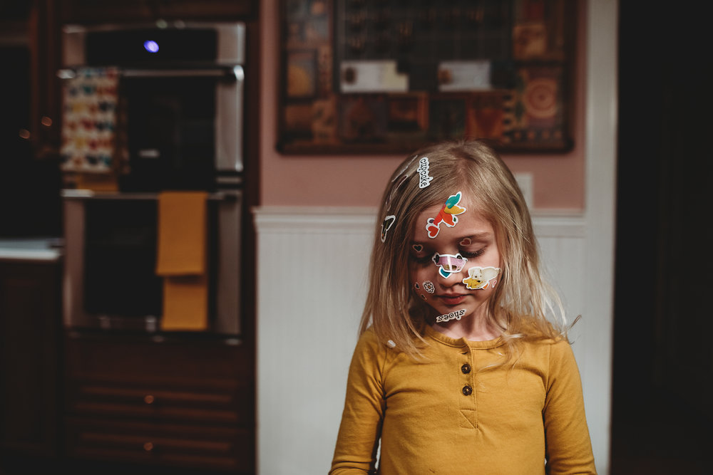 hello-olivia-photograph-long-island-photographer-family-little-girl-stickers-on face.jpg