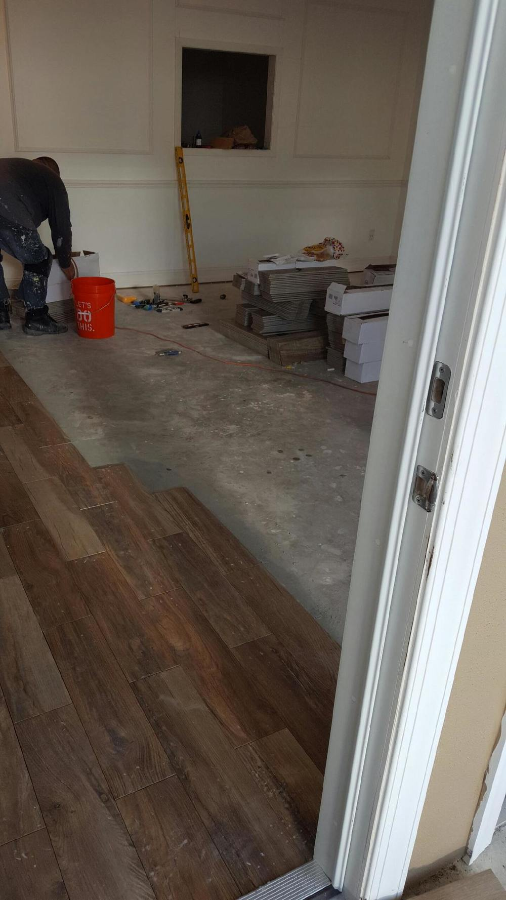A little trick: laying the tile close together and giving it very thin grout lines mimics the look of natural wood!