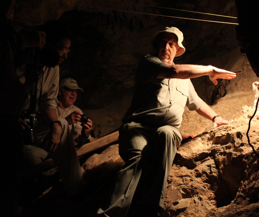 """2011, SOUTH AFRICA: With Dr Ron Clarke to examine his discovery of Australopithecus prometheus or """"Little Foot""""still in situ, at the Sterkfontein caves. Embedded in rock, the skeleton took 15 years to recover. In 2015, it was dated to 3.67 million years old and the footbones provided evidence of bipedalism (walking on two legs)."""