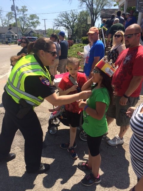 5/22 RD Sgt Massie giving out Jr Deputy Sheriff stickers - Long Grove Chocolate Fest