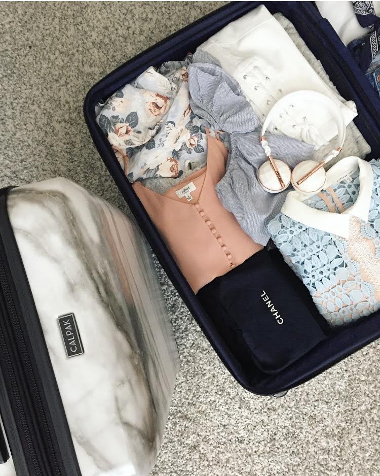 calpak-astyll-marble-luggage.jpg