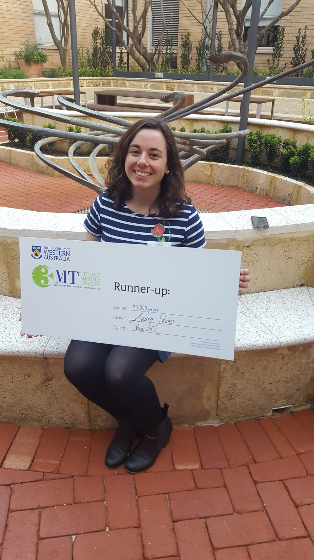 Here I am after coming Runner Up in this year's 3 Minute Thesis competition! Thanks to my mum for the photo!