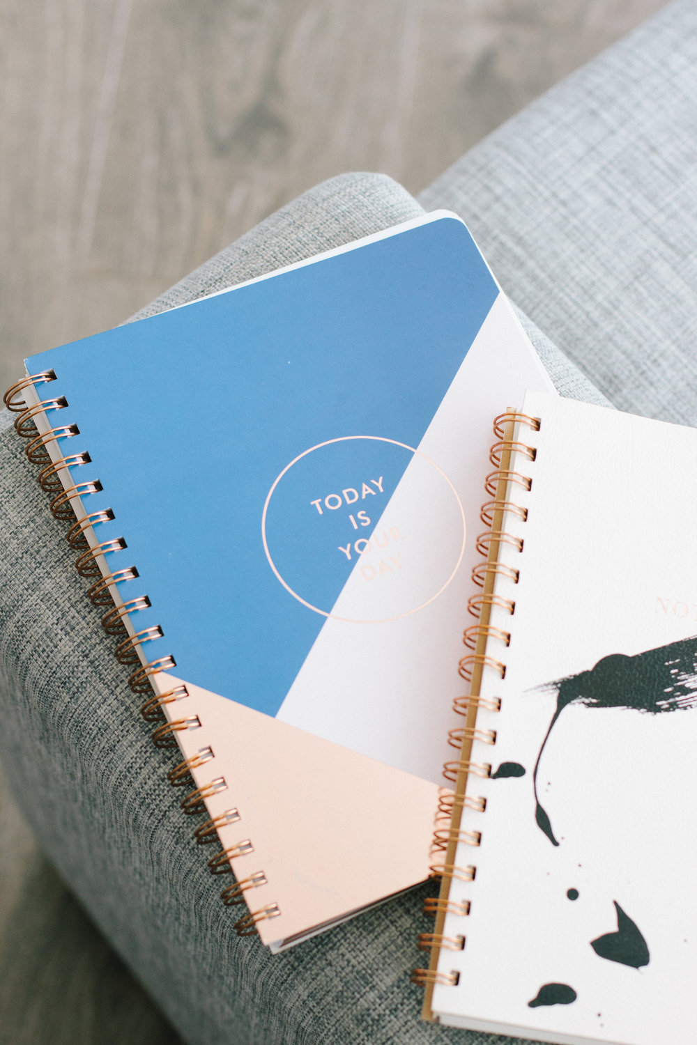 Big and small notebooks we use for staying organized as small business owners