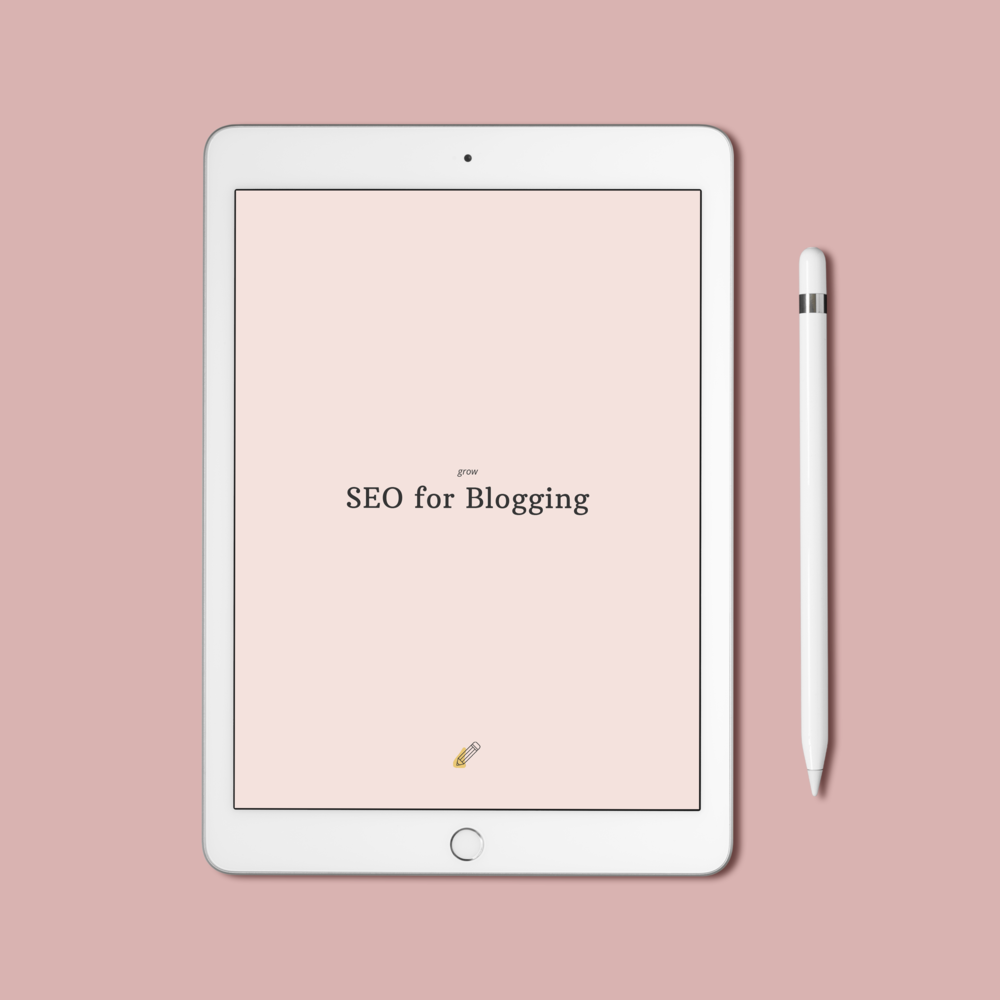 SEO for Blogging guide on an iPad and a pink background