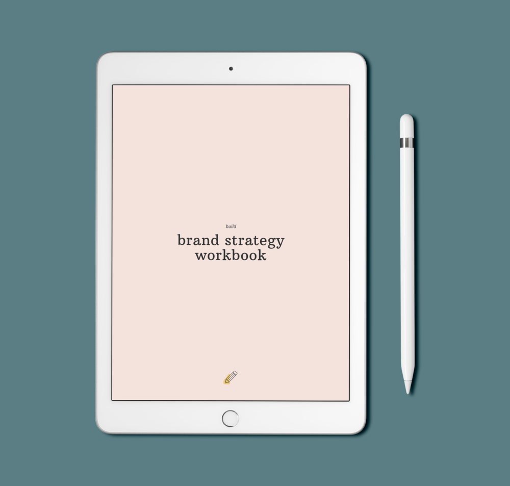 iPad mockup of the brand strategy workbook on a blue background