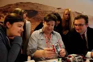 Even teachers enjoy the hands-on nature of robotics!