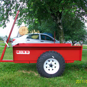 RD 3060 trailer, 2 wheels, tilting, all terrain with rear panel, 30 '' x 60 '', next to 14 ''.