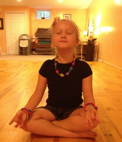 My daughter, Lexi, at 5 years old meditating.