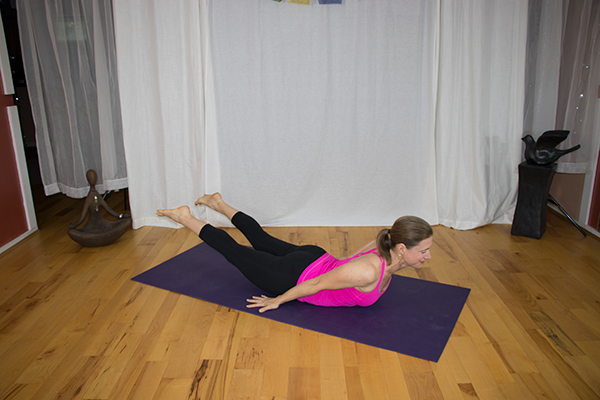 Strenghten Your Back with this Yoga Pose and say goodbye to lower back pain. Locust Pose variation. www.irenamiller.com
