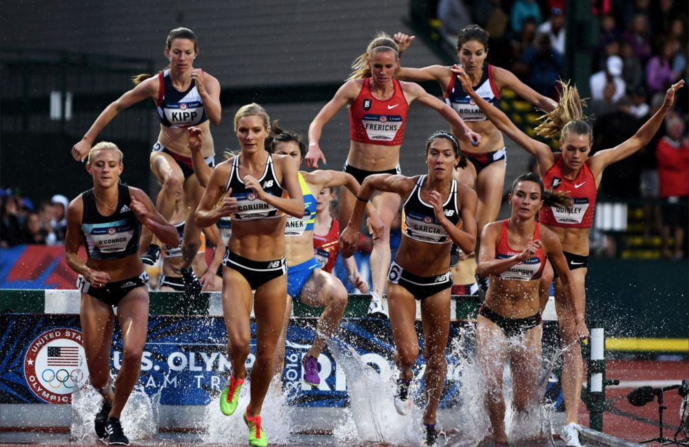 Emma Coburn edged her competition in the women's 3,000-meter steeplechase final.