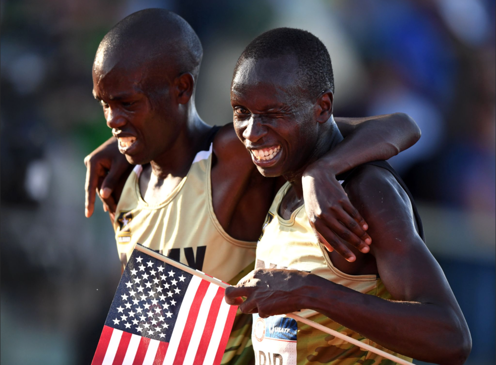 U.S. Army teammates Shadrack Kipchirchir, left, and Leonard Korir celebrate after finishing second and third in the 10,000-meter final, stamping their trips to Rio.