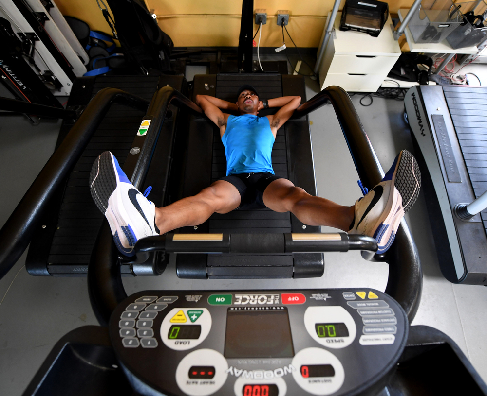 If anyone deserves a relaxing cooldown, it's Merritt, seen here stretching out on a treadmill at the EXOS facility in Scottsdale, Arizona. The Olympic athlete underwent a kidney transplant last September.