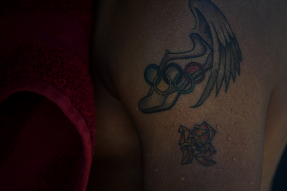Merritt's tattoos pay tribute to his gold at the London Games in 2012 with a time of 12.92. A month later, he broke the world record in the 110 hurdles at 12.80, bettering the previous mark by seven-hundredths of a second. It was the largest drop in the record in 31 years.