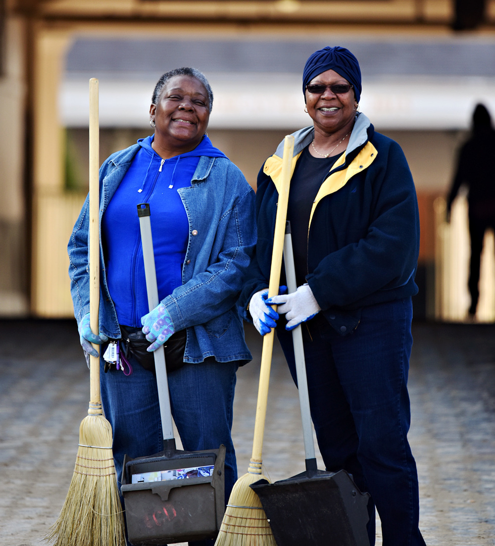 "Betty Bailey, left, and LaVerne Johnson have been sweeping at Churchill Downs for five years as part of a fundraiser for Cable Baptist Church. Bailey said ""We're cleaning for Christ."""