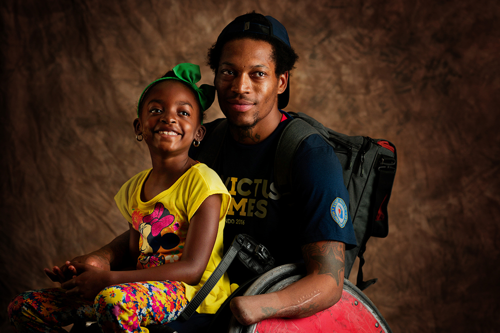 Anthony McDaniel, 27, and his daughter, Dejah, 7. McDaniel is a Marine Corps veteran originally from Pascagoula, Mississippi. He captained the gold medal-winning rugby team, won a gold medal in basketball and bronze in rowing and 100 meters.