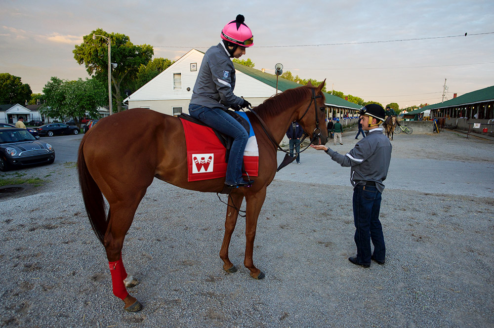 Hernandez feeds a stable pony some candy at the barns on Thursday at Churchill Downs. The Louisiana-born Hernandez is looking to continue a tradition of Derby-winning jockeys from that state, one that includes Calvin Borel, Kent Desormeaux and Eddie Delahoussaye.