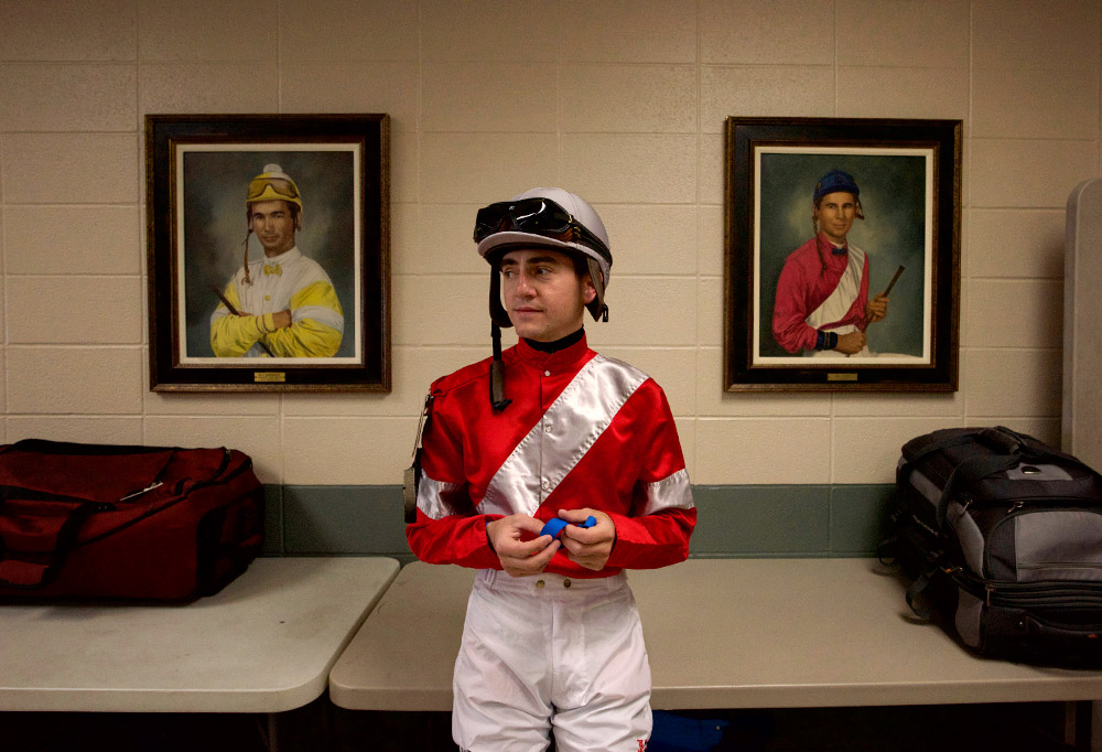 Hernandez stands before portraits of past Derby winners, including Bill Shoemaker (left) in the jockey lounge at Churchill Downs on Tuesday. The legendary Shoemaker, who died in 2003, was a four-time Derby winner.