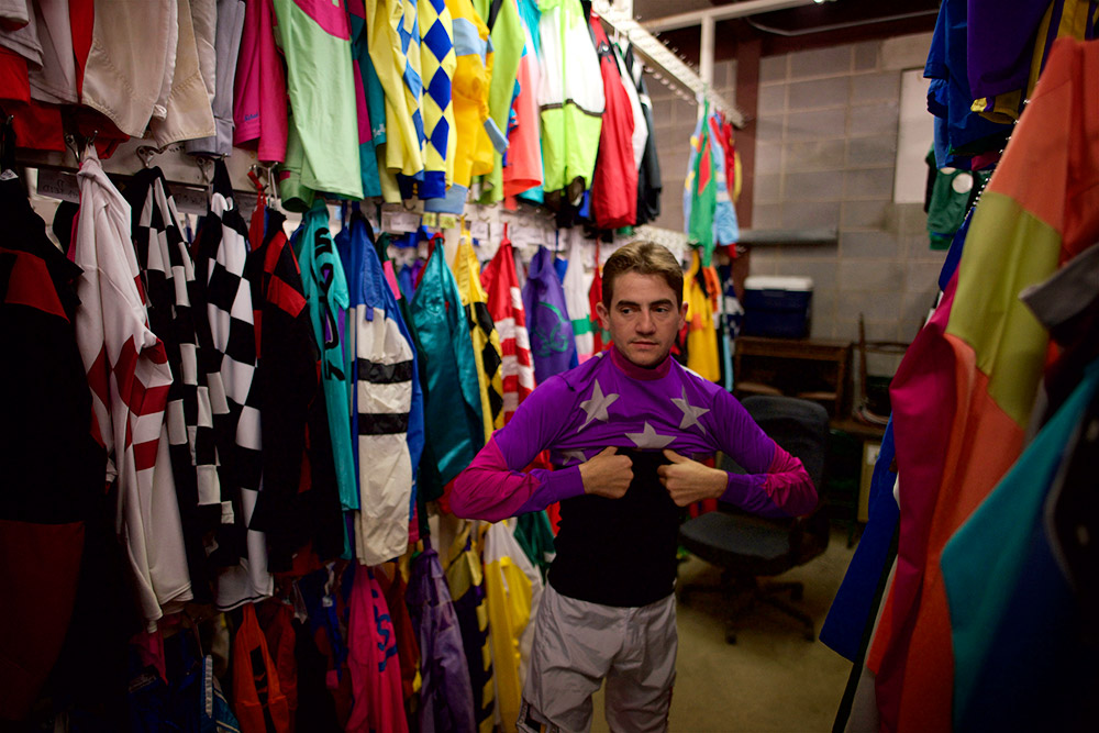 Hernandez puts on his jersey in the silks room at Churchill Downs on Tuesday. Hernandez's most famous ride to date came in a win in the Breeders' Cup Classic, aboard Fort Larned, on Nov. 3, 2012.