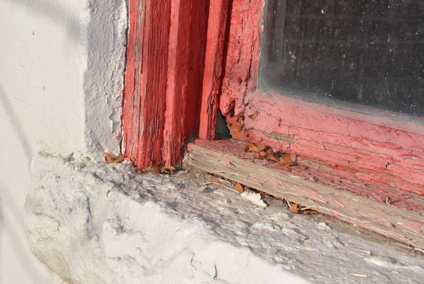 Weather-rotted window sill