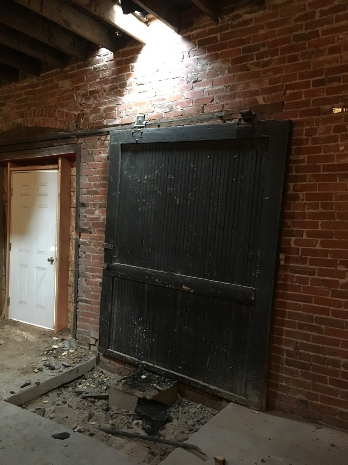 This original sliding door will be restored and rehung in the area that will be our Teaching Kitchen.