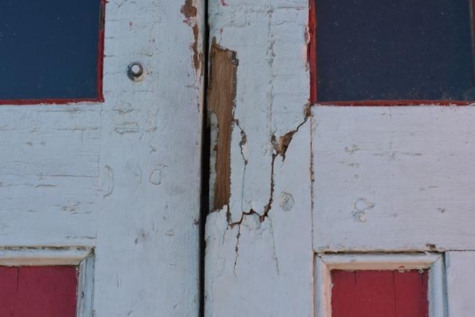 Door damage needing repair.
