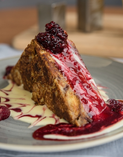 The Café's seasonal Brioche Bread Pudding French Toast made with with blackberries from our farm.