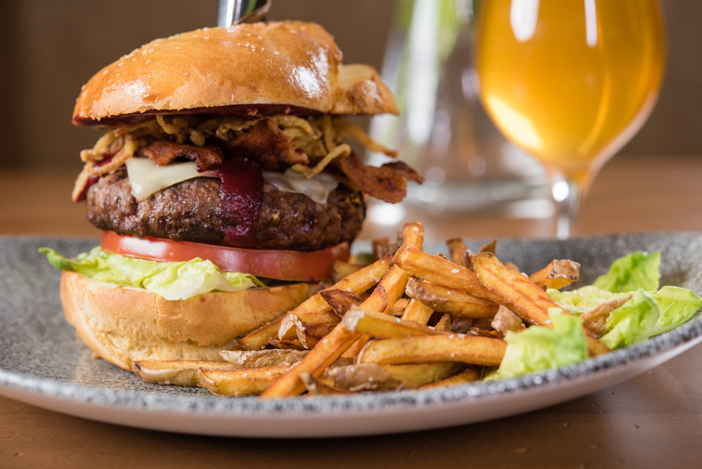 The Ralphie Burger, ready for gustatory destruction at the Rooftop bar. Colorado bison, local veggies,housemade bun and handcut fries.