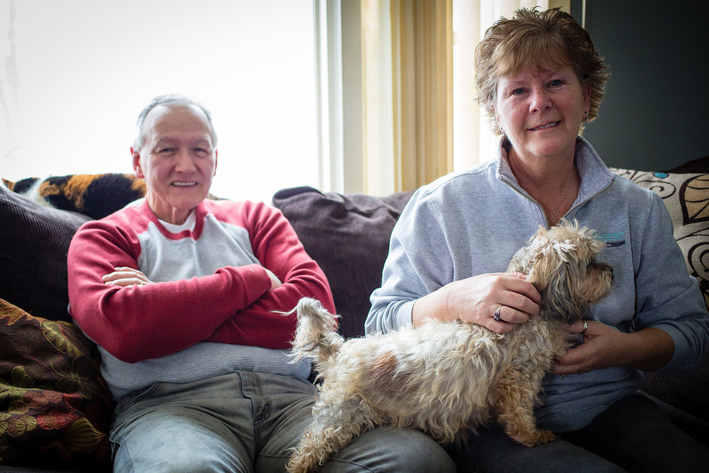 "Patty Blowers, 56 pictured with her husband ""Bing"" and pup Hannah at their home in Moravia, New York // February 4, 2018"