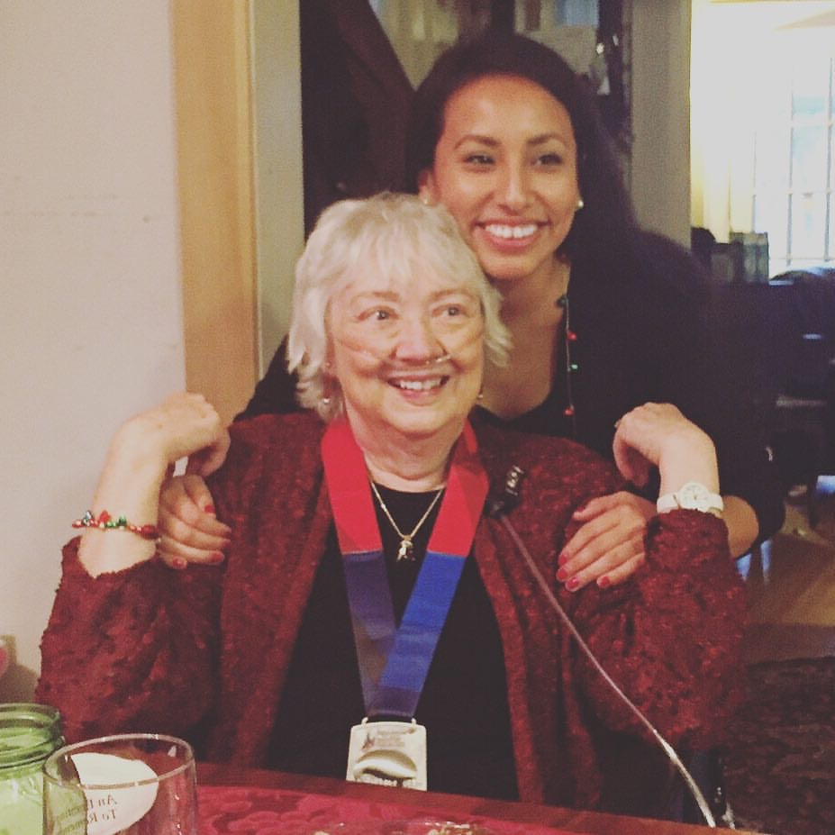 Marilyn's daughter Elle presenting her mom with the Chicago Marathon ribbon, which she completed in her honor October 2015 / Family Photo