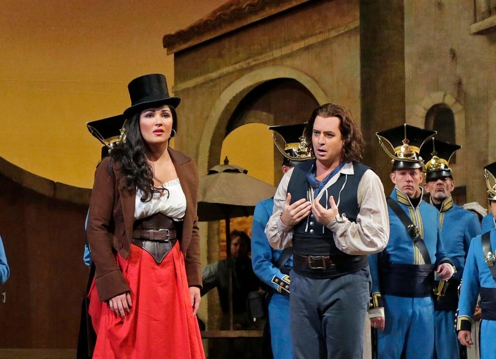 Anna Netrebko as Adina and Matthew Polenzani as Nemorino in  L'Elisir d'Amore . Photo by Ken Howard; courtesy of Metropolitan Opera.