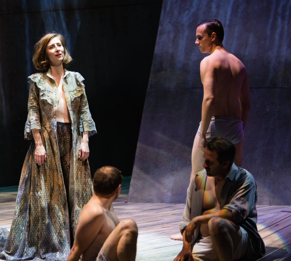 Kiera Duffy as Bess with other men.  Photo by Dominic M. Mercier and courtesy of Opera Philadelphia.