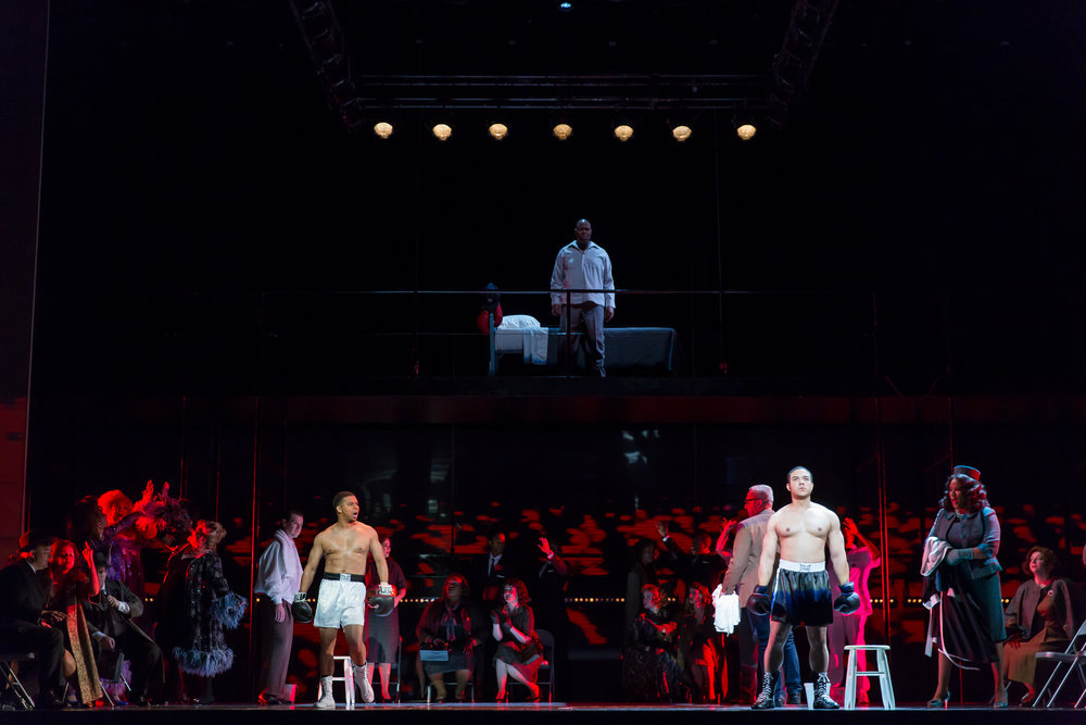 "Old Emile, Arthur Woodley, from his nursing home room looks down on Benny ""The Kid"" Paret, Victor Ryan Robertson, young man Emile, Aubrey Allicock. Photo by Scott Suchman and courtesy of Washington National Opera."